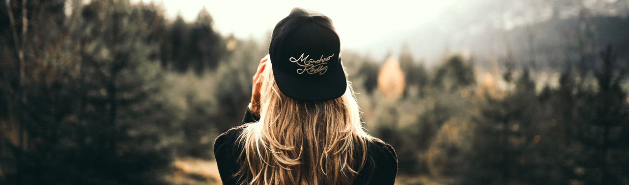 Picture of a girl wearing a custom printed beanie hat