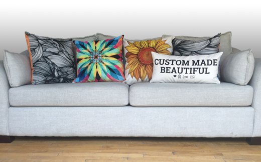 Art of Where pillows on a sofa