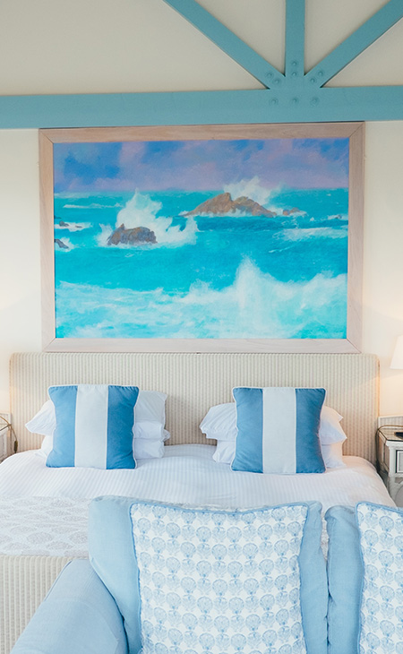 Beach-themed bedroom with two custom printed cotton canvas pillows on the bed