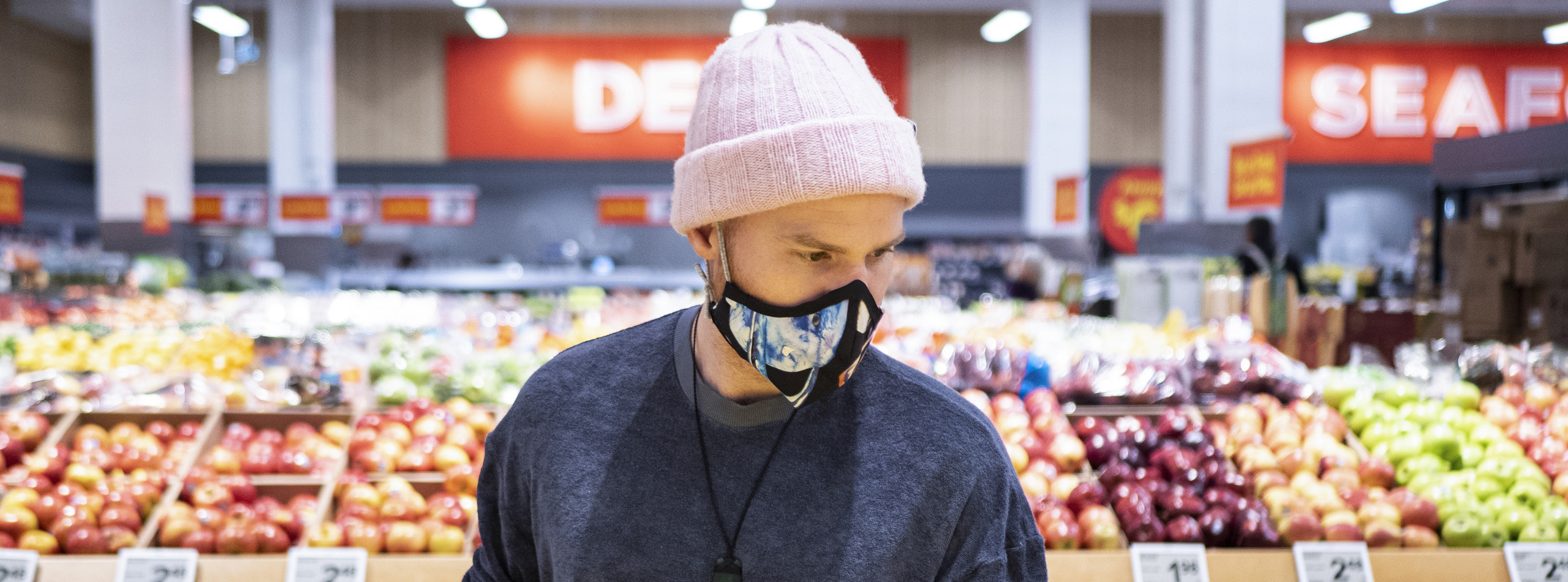 Man with face covering in grocery store