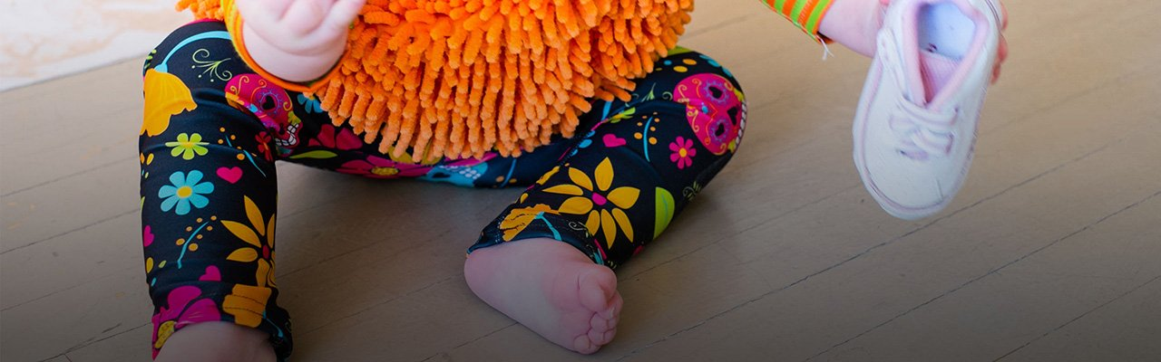 Picture of a baby wearing custom printed leggings