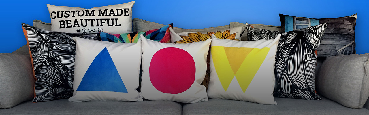 Picture of custom printed pillows on a couch