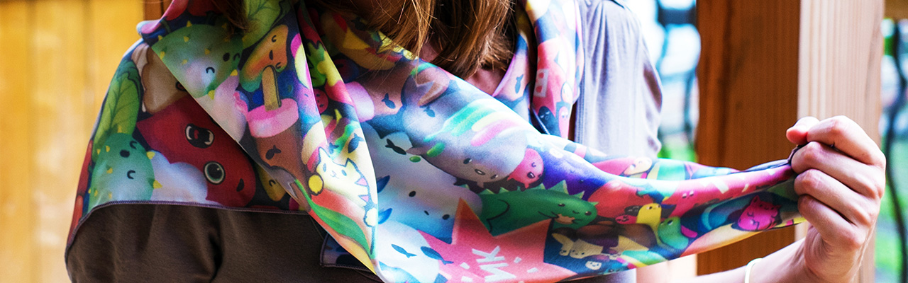 Picture of a girl wearing a custom printed silk scarf